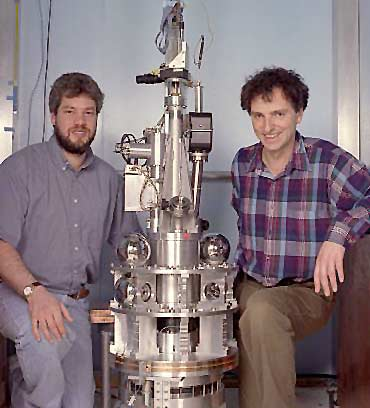 Steve Merkowitzz (l) and Jens Gundlach (r) with the Cavendish apparatus developed at the University of Washington. (Credit: Mary Levin, University of Washington)