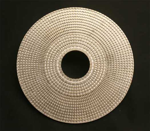 Image of a metamaterial whose structure allows us to control acoustic waves. It's actual size is about the size of a computer or video disk.