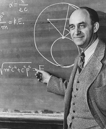 This picture of Enrico Fermi, appearing on a recently issued stamp, contains, in the upper left corner, an incorrect formula for alpha. Proving that even Nobel Laureates make mistakes… (Credit: University of Chicago, courtesy AIP Emilio Segre Visual Archives.)