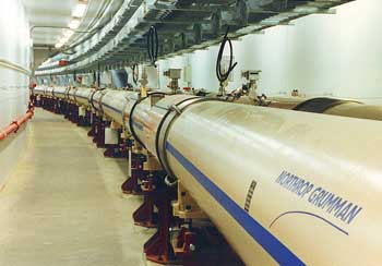 The twin curved tubes at RHIC that contain the counterrotating gold beams, which can be brought together to collide at six instrumented areas around the ring.