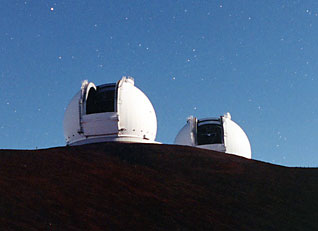 The twin Keck telescopes, one optical and one infrared, on the Mauna Kea volcano in Hawaii (photo courtesy W. M. Keck Observatory)