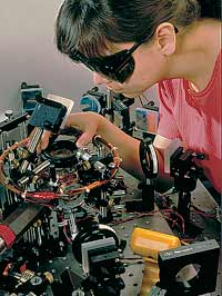 Physicist Deborah Jin of the National Institute for Standards and Technology (NIST) aligning an infrared laser in apparatus designed to create a Bose-Einstein Condensate of rubidium atoms