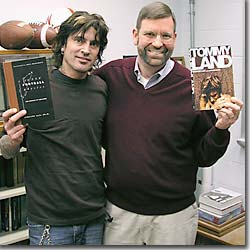 Tommy Lee and Timothy Gay with books.