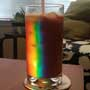 Light refracts through an empty glass to produce a rainbow of color