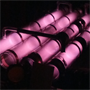 Low-pressure helium gas glows an eerie, soft pink color