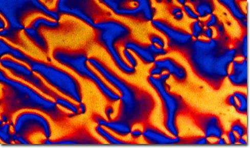 Cigar-shaped liquid crystal molecules move randomly but can all point in the same direction, leading to pretty colors.