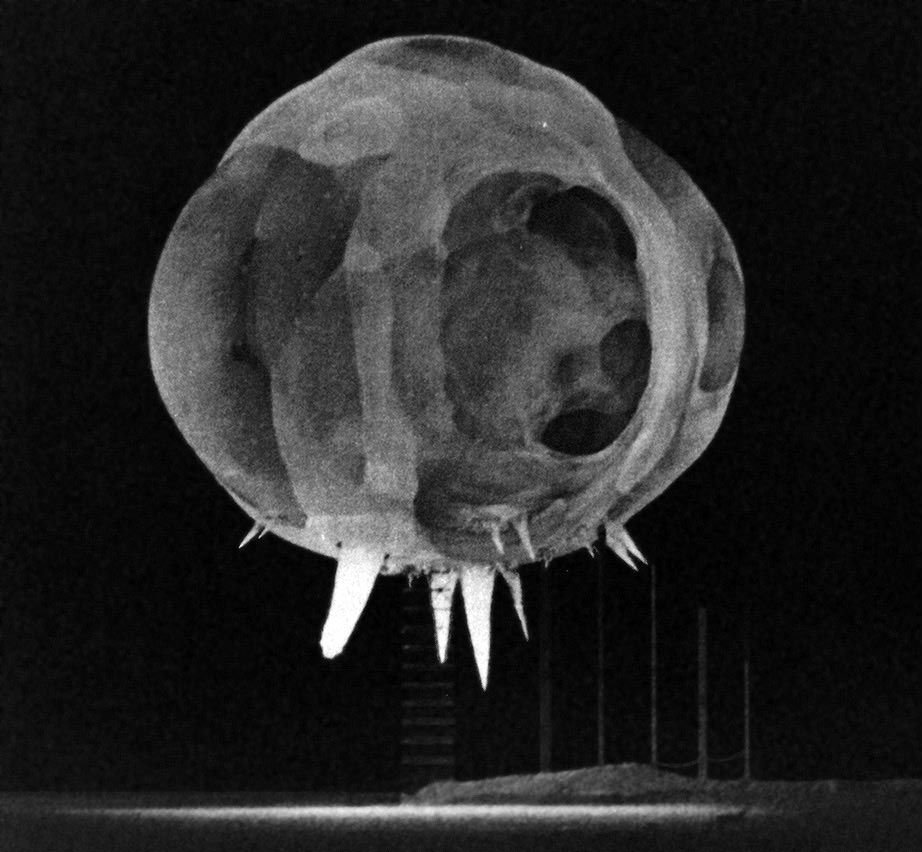 Milliseconds after detonation, spikes of bright light emanate from the bottom of a nuclear fireball.